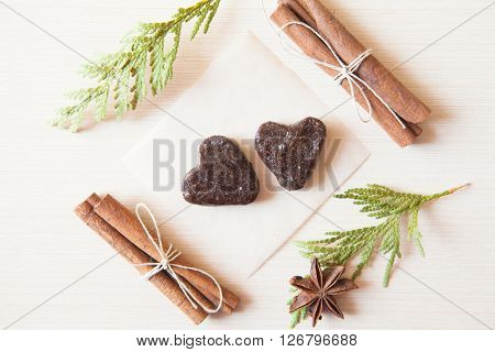 Heart-shaped Raw Candies Made Of Date Fruit,nuts Decorated With Cinnamon Sticks,cardamom,thuja Branc