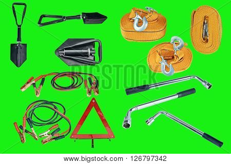 Elements of the essentials for a passenger car. Danger Safety Warning Triangle Sign, towing rope, fire extinguisher, Jumper cable, wheel wrench and shovel. Green screen, chroma key.