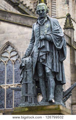 A statue of Adam Smith along the Royal Mile in the historic city of Edinburgh Scotland.