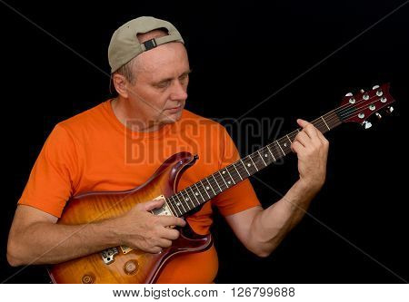 Portrait of amateur musician playing guitar .