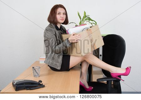 Upset Business Woman Carrying Office Belongings After Loosing Her Job