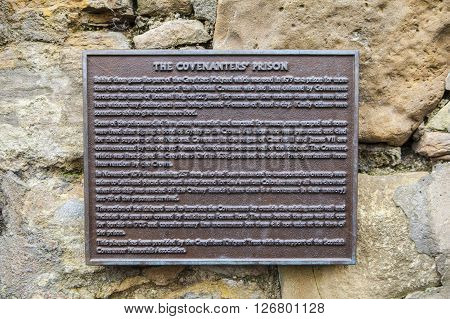 A plaque detailing the location of the Covenanters Prison in Greyfriars Churchyard in Edinburgh.