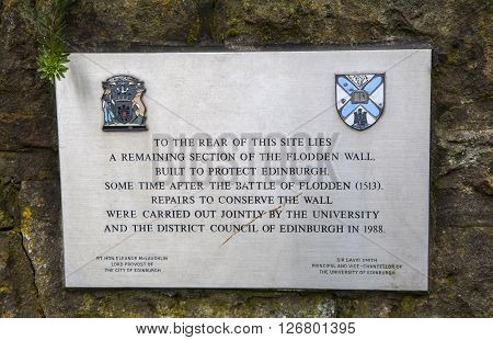 EDINBURGH SCOTLAND - MARCH 9TH 2016: A plaque noting one of the remaining sections of the historic Flodden Wall on The Pleasance in Edinburgh on 9th March 2016.