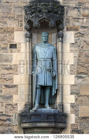 A statue of King Robert the Bruce on the facade of Edinburgh Castle in Scotland.