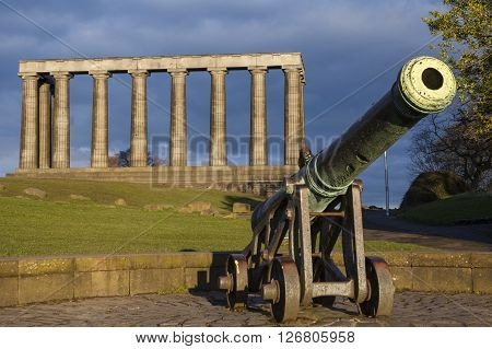 A view of the National Monument of Scotland and a Cannon situated on Calton Hill in Edinburgh.