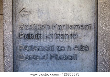 Direction sign for the entrance to the Scottish Parliament Building in Edinburgh Scotland.