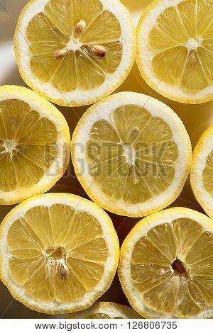 Fresh halved yellow lemons on a plate