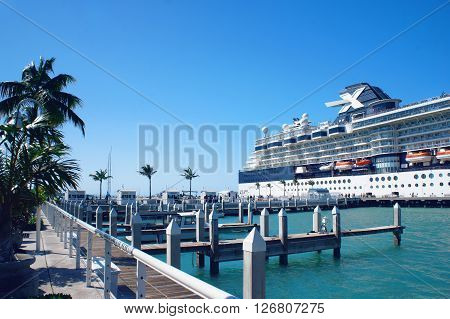 KEY WEST, UNITED STATES - FEBRUARY 6: People walk at the sunny Key West pier near cruise ship and Atlantic Ocean on 6th of February, 2016 in Key West.