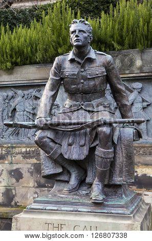 EDINBURGH SCOTLAND - MARCH 10TH 2016: The main statue of the Scottish American Memorial in West Princes Street Gardens Edinburgh on 10th March 2016.