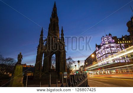 A view of the Scott Monument and traffic trails traveling down Princes Street in Edinburgh Scotland.