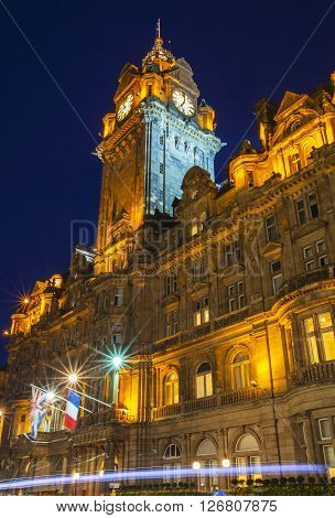 EDINBURGH SCOTLAND - MARCH 10TH 2016: A night-time view of the historic Balmoral Hotel located on Princess Street in Edinburgh on 10th March 2016.