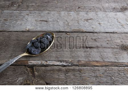 Raisins Photo Of In Metal Spoon On Brown Table