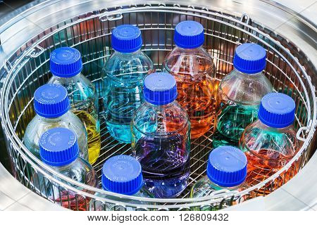 MOSCOW RUSSIA - April 12 2016: The 14th International Exhibition of laboratory equipment and chemical reagents in Moscow. Medical and laboratory equipment at the exhibition. Focus on of laboratory flasks