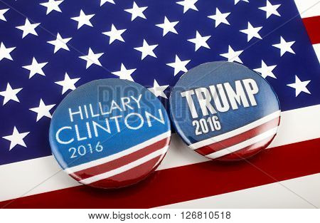 LONDON UK - MARCH 3RD 2016: Hillary Clinton and Donald Trump pin badges over the American flag symbolizing their battle to become the next President of the United States 3rd March 2016.