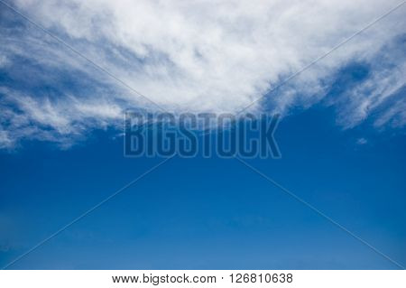 white continuous clouds against the blue sky