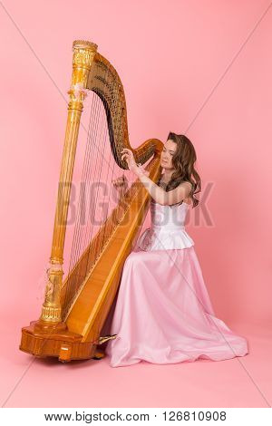 portrait of a girl playing the harp