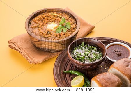 Pav Bhaji or paav bhaji, Indian spicy fast food with bread, onion and butter, Indian food, Mumbai food