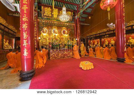 Bangkok Thailand - March 6 2016 : Thai monk worship in temple at Wat Mangkon Kamalawat (Wat Leng Noei Yi). Wat Leng Noei Yi is the most important Chinese Buddhist temple in Bangkok Thailand.