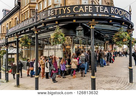HARROGATE UK - NOVEMBER 17 2012: People waiting to enter the famous Bettys Tearoom in Harrogate North Yorkshire UK