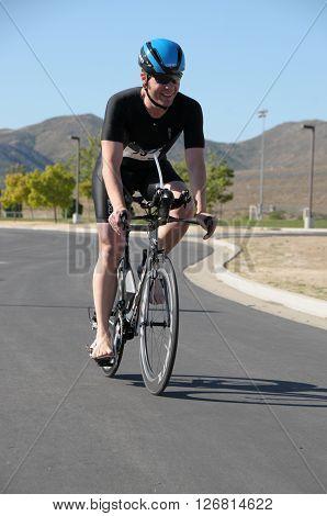 Hemet California/USA-April 17 2016:Athlete on bike in the Diamond Valley Triathlon