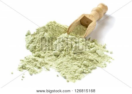 Dry powder Japanese horseradish (wasabi) in a scoop on a white background