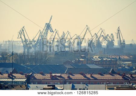 Urban view from height of cargo cranes in Saint-Petersburg port Russia - industrial sunny landscape
