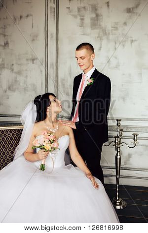 Charming bride and groom on their wedding celebration in a luxurious interior. ** Note: Visible grain at 100%, best at smaller sizes