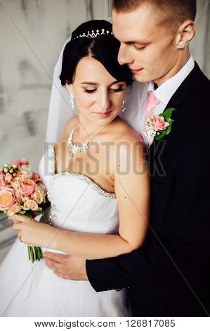 Charming bride and groom on their wedding celebration in a luxurious interior.
