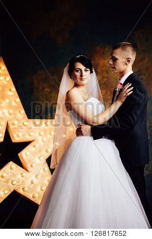 Charming bride and groom on their wedding celebration in an interior. ** Note: Visible grain at 100%, best at smaller sizes
