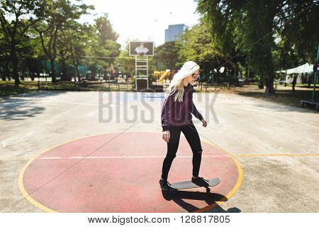 Young Woman Skater Skating Active Concept