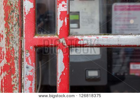 Detail of old red English phone booth box United Kingdom