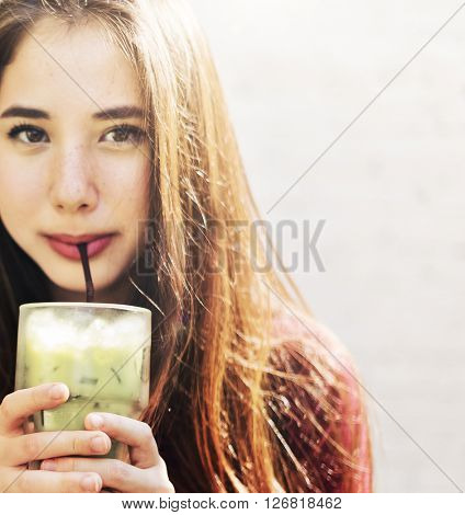Young Woman Drinking Cold Tea Concept