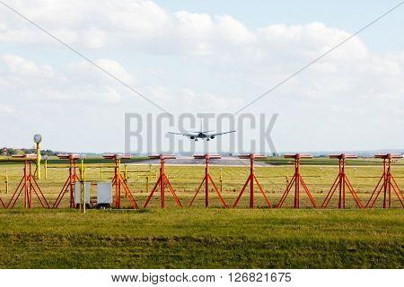 Plane landing on runway
