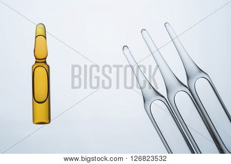 Ampoules isolated on white background, close up