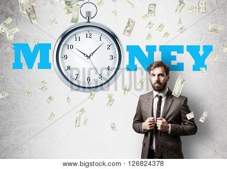Time is money concept with businessman clock and money rain and concrete background