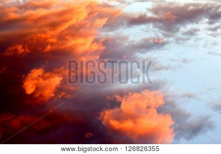 Beautiful orange sky like a painting with sunny clouds