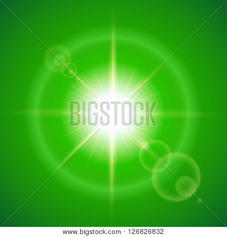 Glaring sun with lens flare over green background