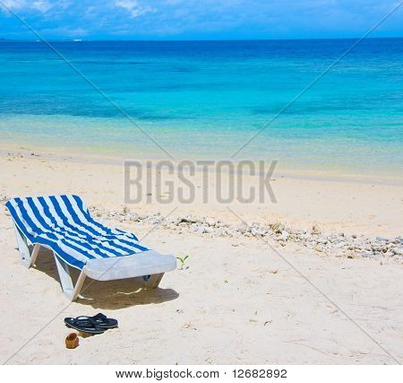 chaise lounge under scorching sun