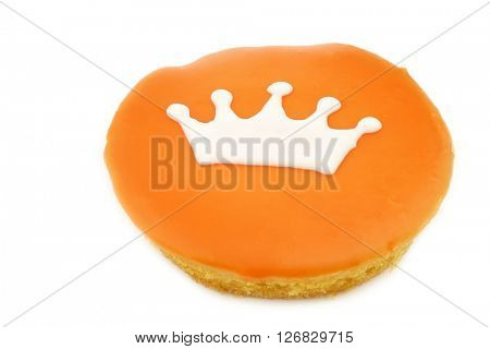 Traditional Dutch pastry with a crown especially produced for King's day on april 27th in Holland on a white background