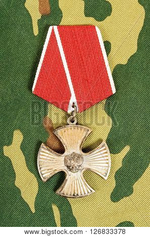SAMARA RUSSIA - APRIL 20 2016: Order of bravery on the camouflage background
