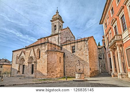 medieval catholic church Collegiata (sec. XIV) ancient cathedral in San Quirico d'Orcia, Siena, Tuscany, Italy