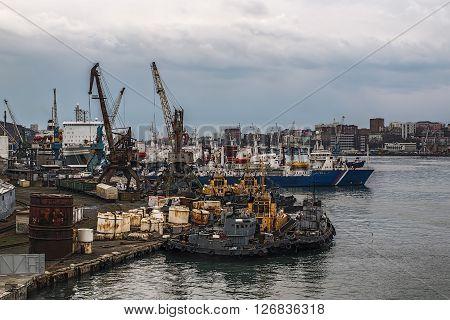 working pier in Vladivostok with moored ships