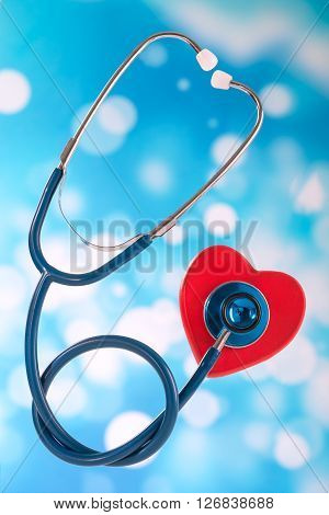 Medical stethoscope and heart isolated on bue