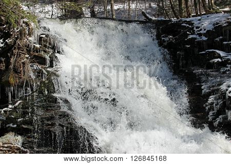 Icy waterfall. One of many waterfalls on the Falls Trail at Ricketts Glen state park in Pennsylvania.