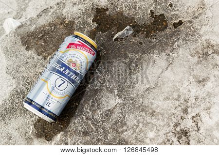UFA - RUSSIA 7TH MARCH 2016 - Single can of Baltika 7 beer resting on winter slush and snow after been thrown away in Ufa Russia 7th of March 2016.