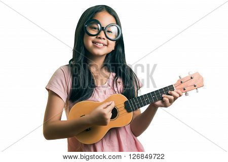 Portrait Of Young Girl With A Ukulele On White