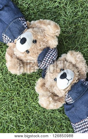 Couple teddy bears rest on lawn two teddy bears relax in garden love and friendship concept