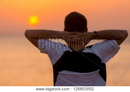 Young Man Enjoying The Sea Landscape