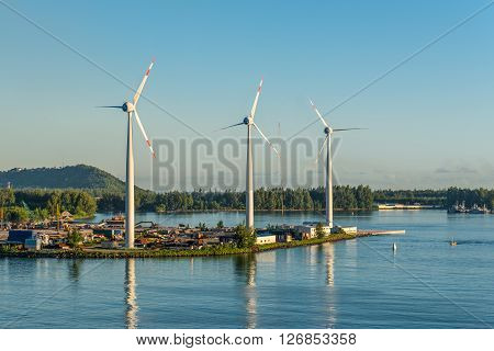 Victoria Mahe island Seychelles - December 15 2015: Wind turbines producing clean electricity at dawn in Victoria Mahe Island Seychelles.