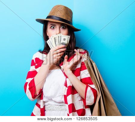 Portrait Of The Young Woman With Shopping Bags And Money